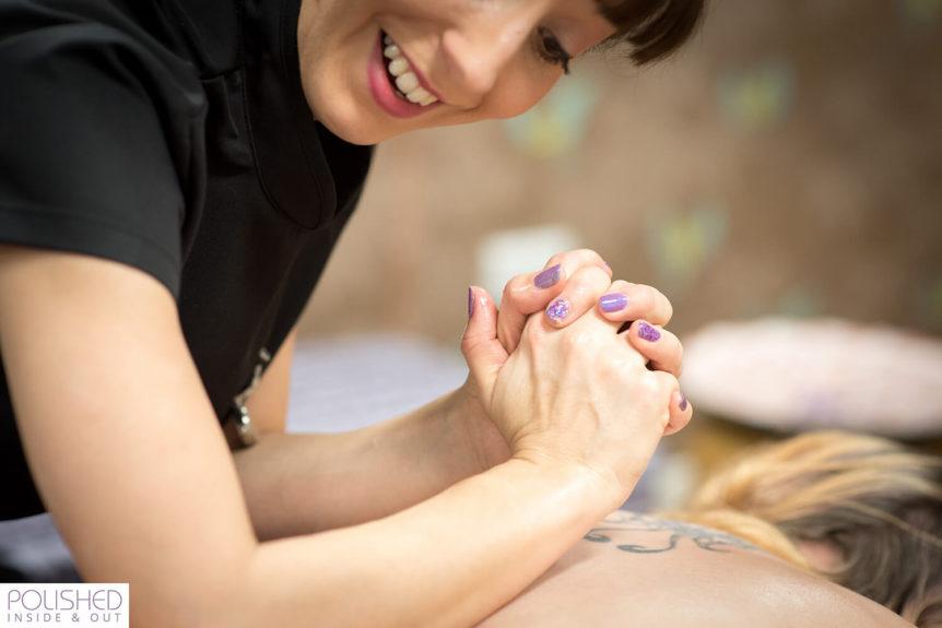 Natasha in action doing a back massage
